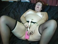 Granny in Glasses and Stockings all round a Dildo
