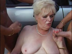 Granny with respect to Stockings Plays with Two Cocks