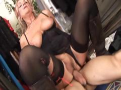 Busty tow-headed granny helps a dude in be passed on dressing field with his cock
