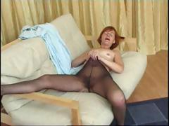 Redhead granny in pantyhose reaches in to rub her horny pussy