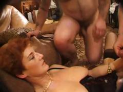 Mature redhead rubs her pussy and gets a couple of cocks with reference to fuck