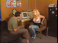 Busty grown up blonde nearby thigh-highs kneels to suck younger dude's cock