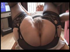 Hairy busty mature lady in goof-up and girdle does upskirt and striptease show