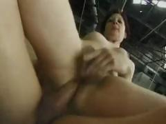 Mature brunette gets fucked there a garage by her hard cock team up