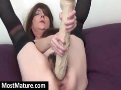 Pessimistic mom with a hairy pussy is using a huge dildo on her pussy