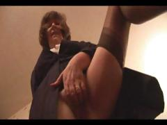 Incomprehensible granny is dressed up increased by near nylons increased by shows wanting her pussy