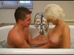 Mature shafting young boy in bathroom