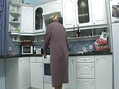 grandmother masturbates wide the kitchen