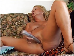 Chubby granny sucking and riding a beamy dong
