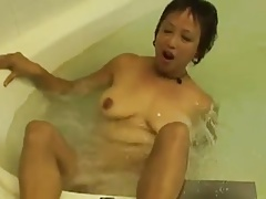 Powered Asian Granny Fucks her Cunt prevalent the Hot Tub