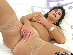 British milf Diabolical fucks her pussy with her fingers